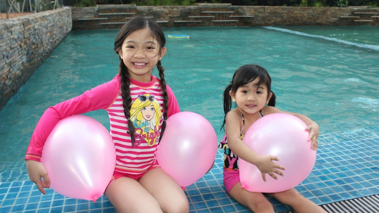 GIANT BALLOONS SURPRISE TOYS Challenge in huge POOL