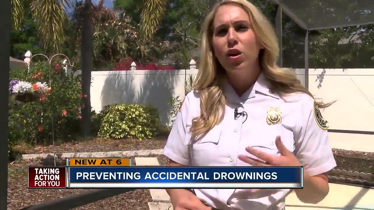 Palm Harbor Firefighters assessing pool safety in local neighborhood